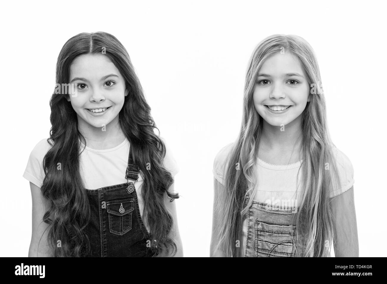 Natural beauty. Healthy and shiny hair. Kid cute child with long adorable hairstyle. Hair care tips and professional treatment. Long hair feminine attribute. Girls usually let their hair grow long. - Stock Image