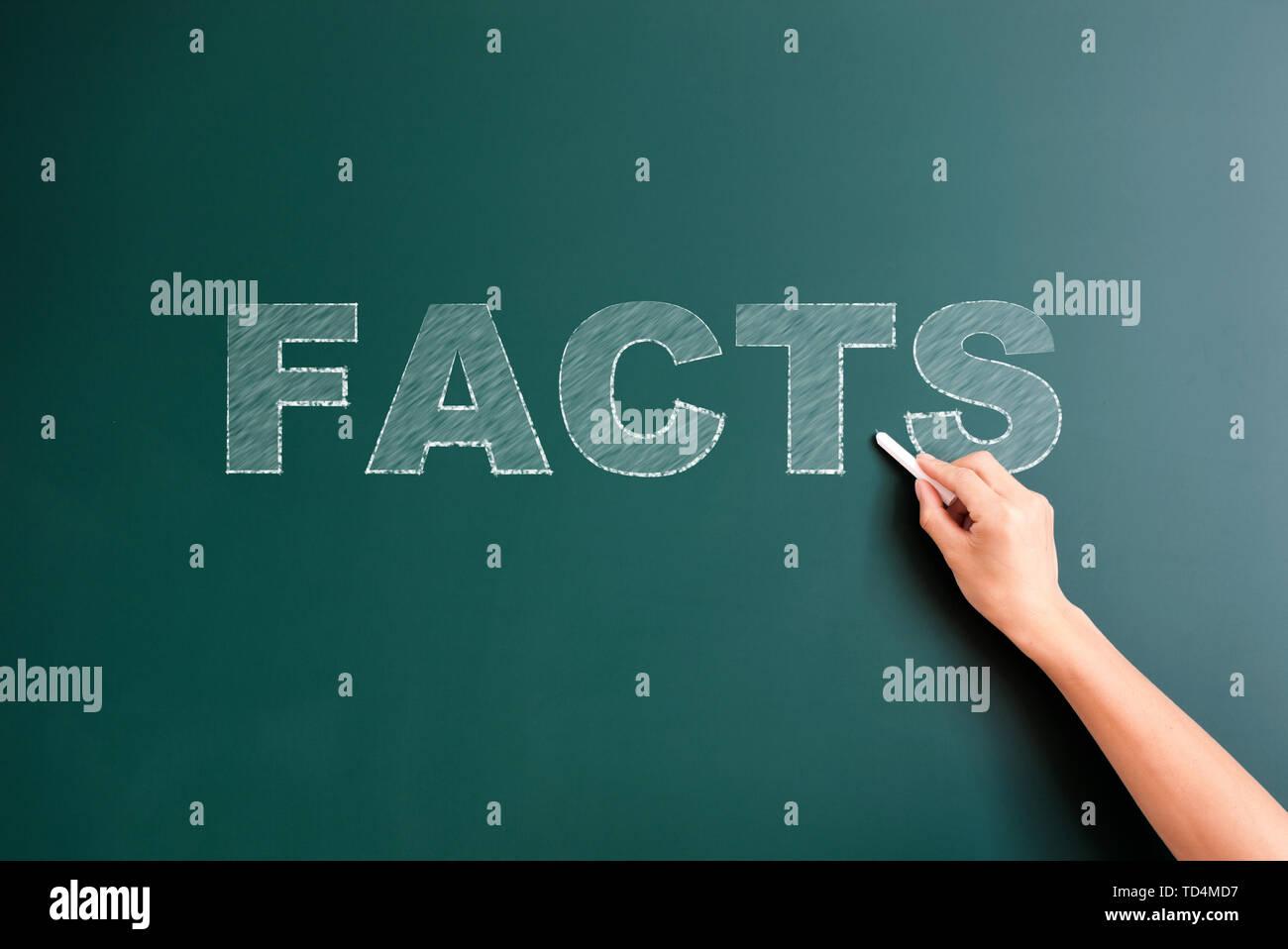 facts written on blackboard - Stock Image