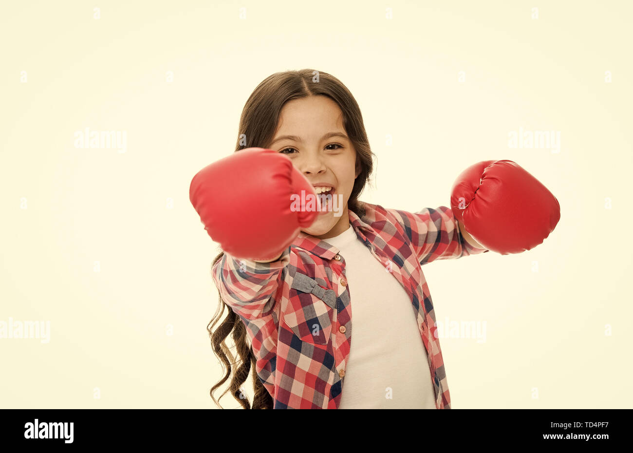 Girl power and feminism concept. Happy kid boxing in gloves isolated on white. Child boxer with long hair boxing for fun. Sport activity and fun leisure. Boxing skill practice. Feminist upbringing. - Stock Image