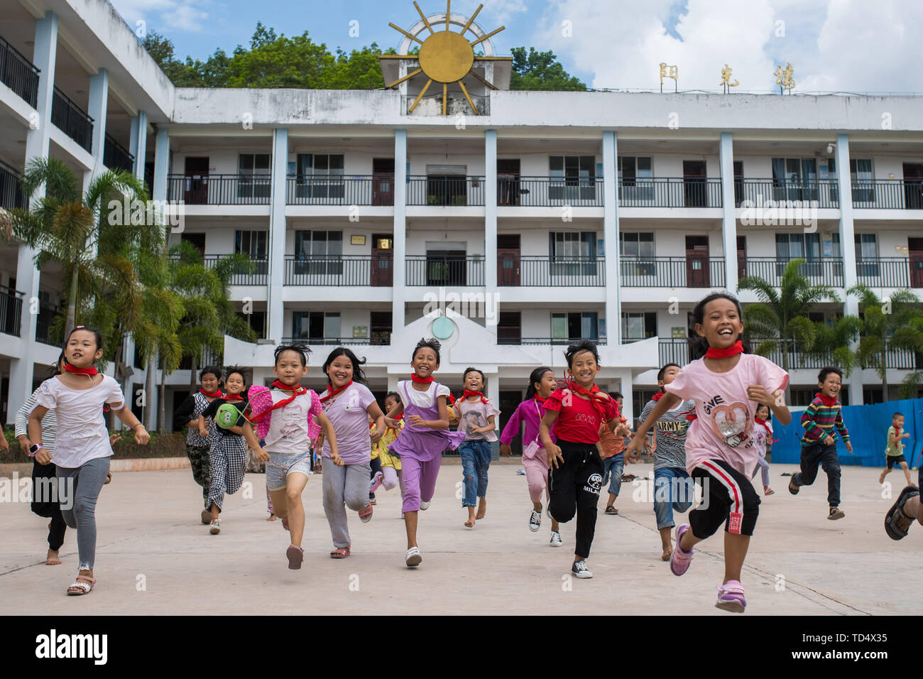 (190612) -- JINGHONG, June 12, 2019 (Xinhua) -- Pupil run at a school in Jino Ethnic Township on Jino Mountain in Jinghong of Xishuangbanna Dai Autonomous Prefecture, southwest China's Yunnan Province, June 11, 2019. With a population of slightly over 20,000, the Jino people had only been officially acknowledged in 1979 as an independent ethnic group of China. Until 1949, most of them had lived for generations in primitive mountain tribes in southwest China's Yunnan Province. Currently, the primary education in Jino Ethnic Township achieved 100 percent coverage for all school-age children. (Xi - Stock Image