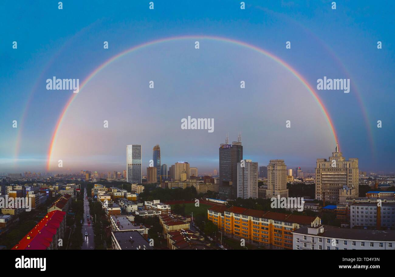 Beijing, China. 11th June, 2019. Stitched aerial photo taken on June 11, 2019 shows double rainbows in Changchun, capital of northeast China's Jilin Province. Credit: Xu Chang/Xinhua/Alamy Live News - Stock Image
