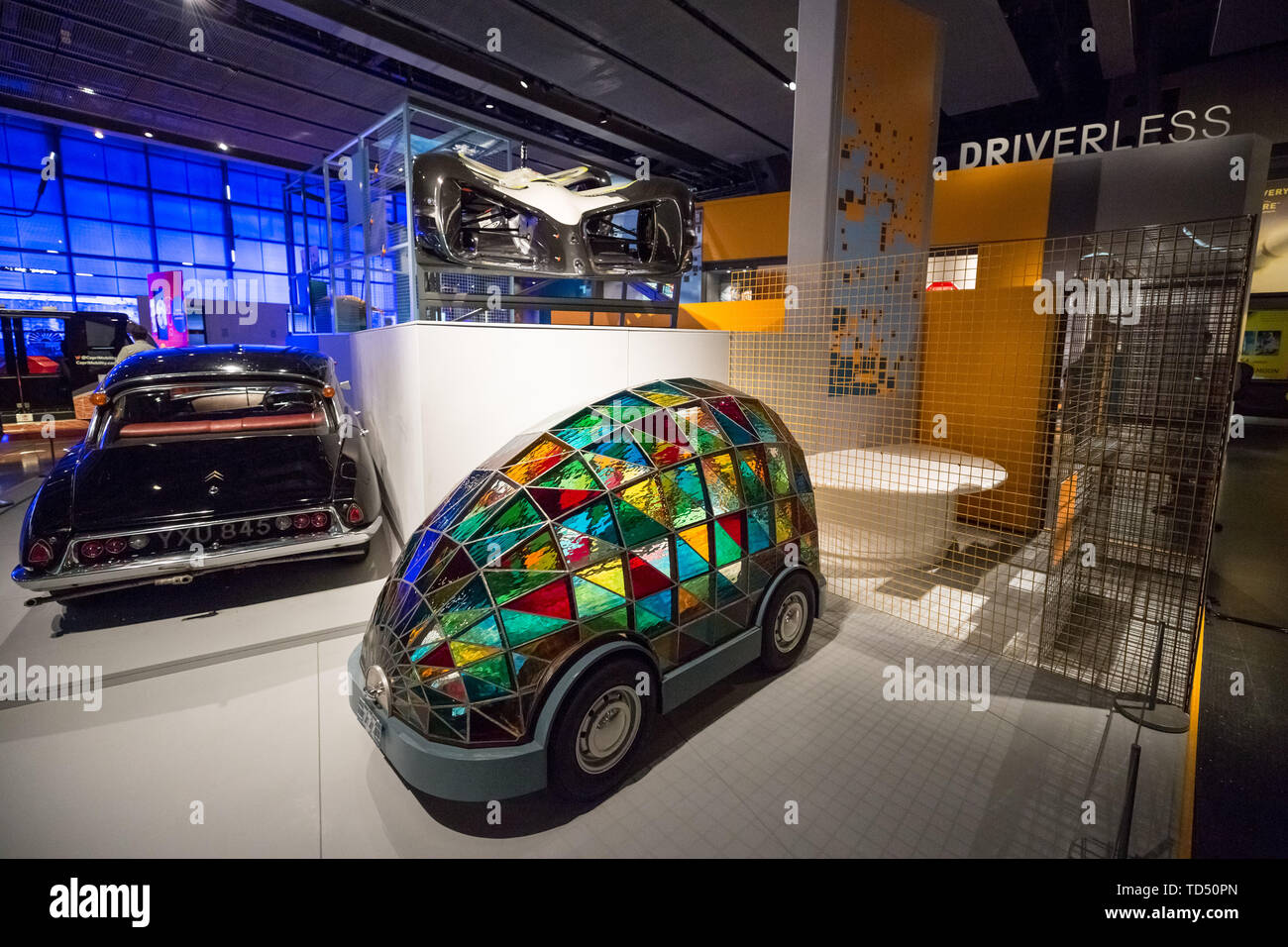 London, UK. 12th June 2019. Driverless technology 'Who is in control?' exhibition is launched the Science Museum. Pictured(centre): 'Stained Glass Driverless Sleeper Car of the Future' designed by artist Dominic Wilcox. Exploring the history of self-driving vehicles, the exhibition also examines how much control we're willing to transfer to them and how their wider deployment could shape out habits, behaviour and society. Credit: Guy Corbishley/Alamy Live News - Stock Image