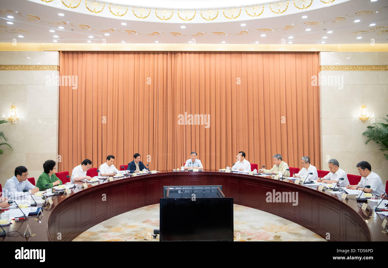 Beijing, China. 12th June, 2019. Wang Yang, a member of the Standing Committee of the Political Bureau of the Communist Party of China (CPC) Central Committee and chairman of the Chinese People's Political Consultative Conference (CPPCC) National Committee, presides over a group study session in Beijing, capital of China, June 12, 2019. The leading Party members' group of the CPPCC National Committee held a group study session Wednesday to study remarks on the Party's united front work in Xi Jinping Thought on Socialism with Chinese Characteristics for a New Era. Credit: Xinhua/Alamy Live News - Stock Image