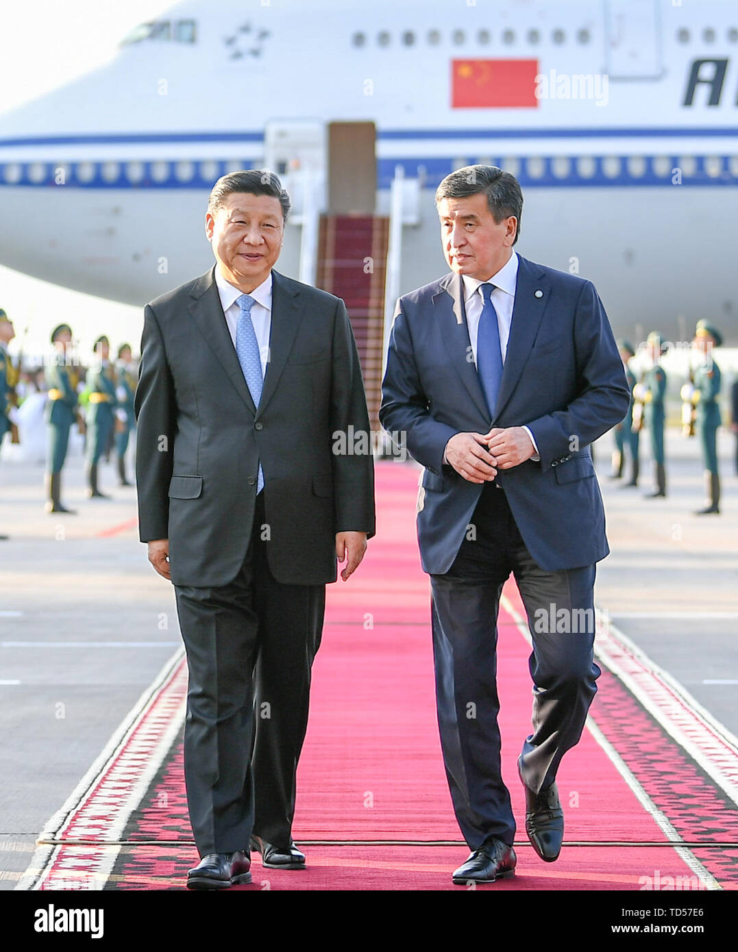 Bishkek, Kyrgyzstan. 12th June, 2019. Chinese President Xi Jinping has a cordial talk with his Kyrgyz counterpart Sooronbay Jeenbekov upon his arrival in Bishkek, Kyrgyzstan, June 12, 2019. Xi arrived here Wednesday for a state visit to Kyrgyzstan and the 19th Shanghai Cooperation Organization (SCO) summit. Credit: Xie Huanchi/Xinhua/Alamy Live News - Stock Image