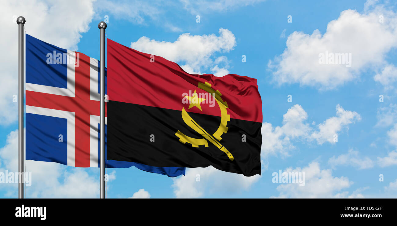 Iceland and Angola flag waving in the wind against white cloudy blue sky together. Diplomacy concept, international relations. - Stock Image