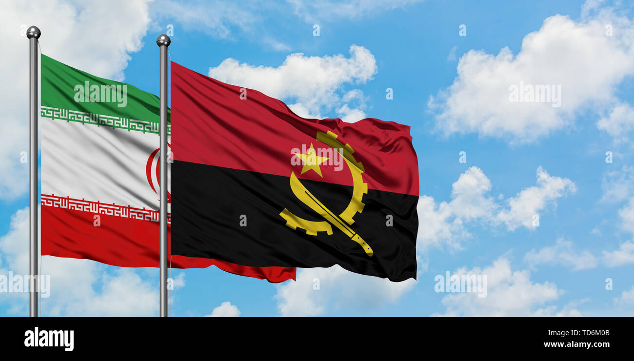 Iran and Angola flag waving in the wind against white cloudy blue sky together. Diplomacy concept, international relations. - Stock Image