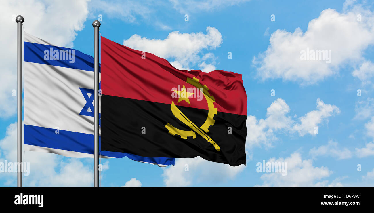 Israel and Angola flag waving in the wind against white cloudy blue sky together. Diplomacy concept, international relations. - Stock Image