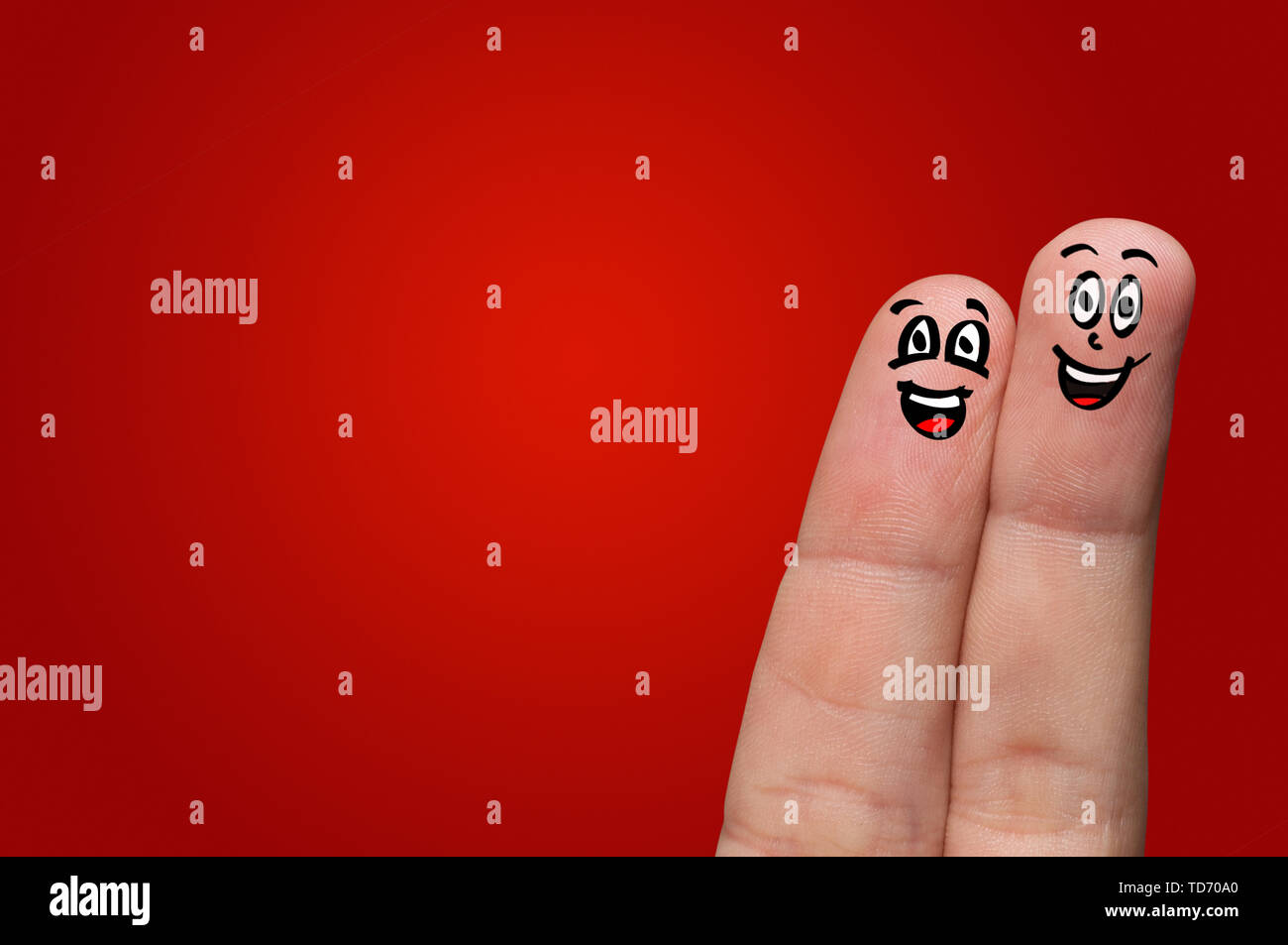 Smart looking fingers smiling and hugging - Stock Image