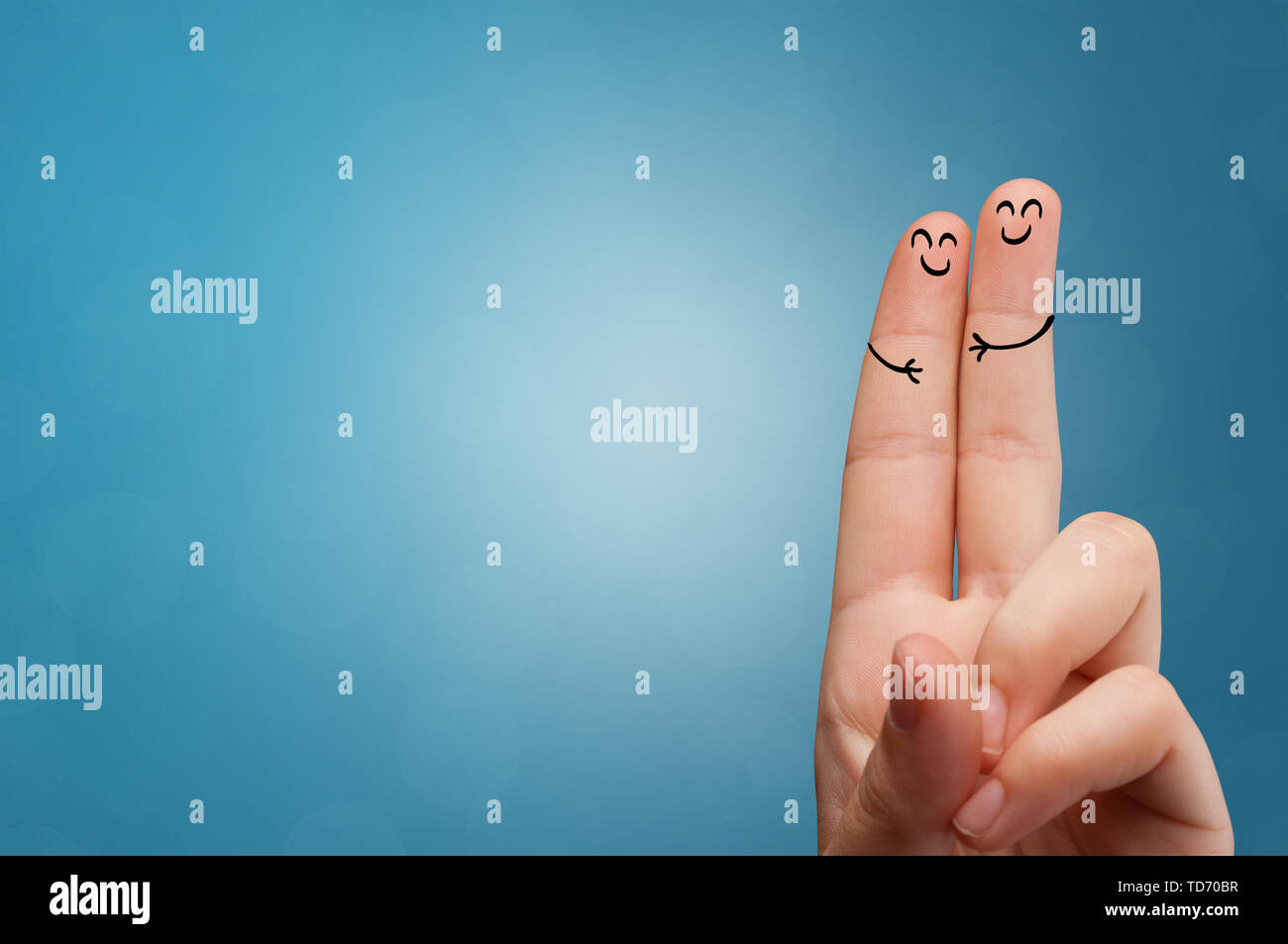 Joyful fingers smiling with colorful background concept - Stock Image