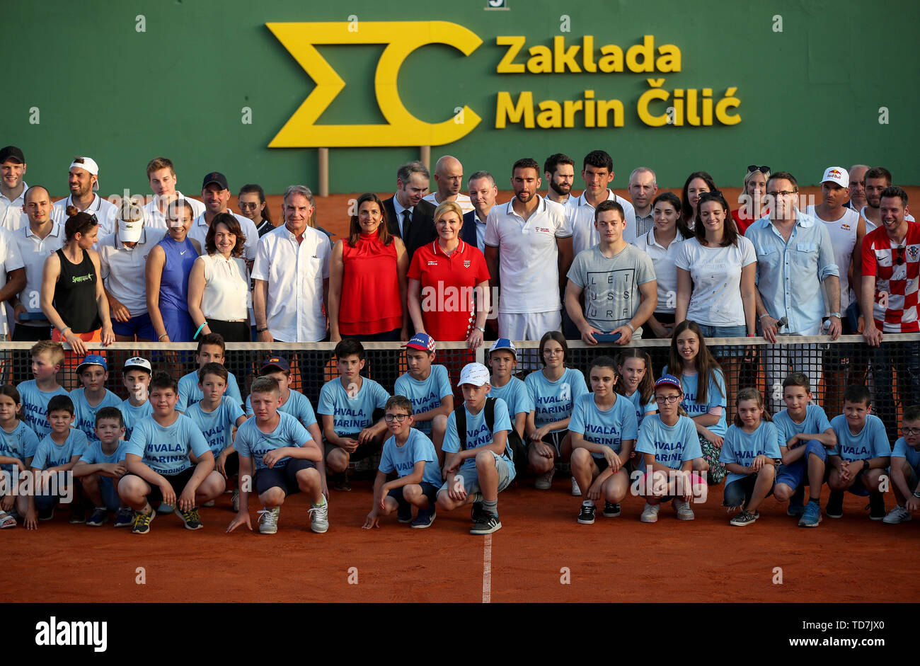 Zagreb, Croatia. 12th June, 2019. Croatian President Kolinda Grabar-Kitarovic (C) poses for a group photo with participants of Gem Set Croatia, a humanitarian sports event organized by the Marin Cilic Foundation, in Zagreb, Croatia, June 12, 2019. Credit: Igor Kralj/Xinhua/Alamy Live News - Stock Image