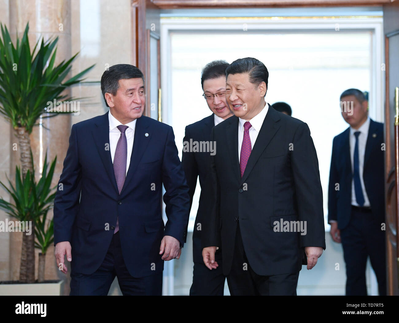 Bishkek, Kyrgyzstan. 13th June, 2019. Chinese President Xi Jinping and his Kyrgyz counterpart Sooronbay Jeenbekov arrive for their talks in Bishkek, Kyrgyzstan, June 13, 2019. Xi and Jeenbekov held talks here Thursday, agreeing to take their countries' comprehensive strategic partnership to new heights. Credit: Yin Bogu/Xinhua/Alamy Live News - Stock Image