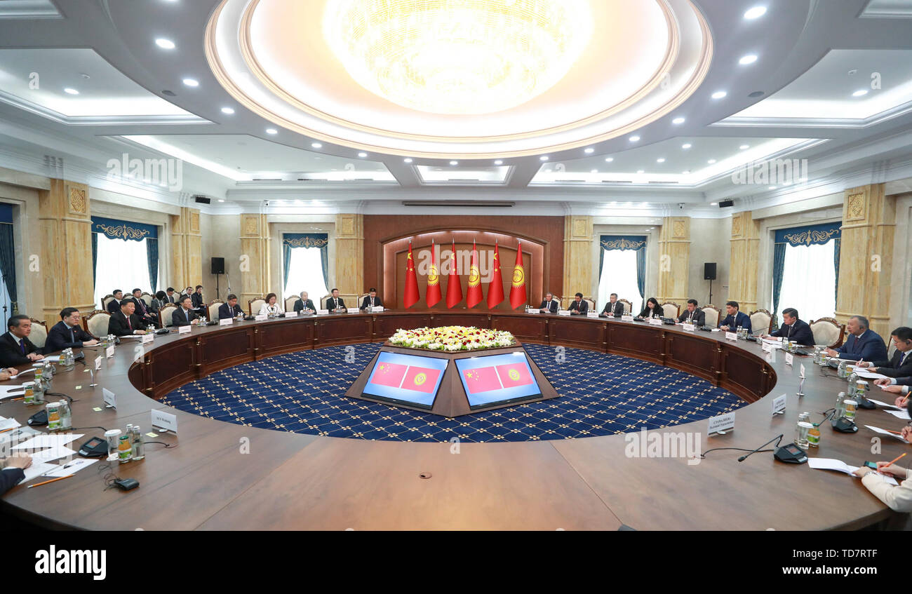 Bishkek, Kyrgyzstan. 13th June, 2019. Chinese President Xi Jinping and his Kyrgyz counterpart Sooronbay Jeenbekov hold talks in Bishkek, Kyrgyzstan, June 13, 2019. Xi and Jeenbekov held talks here Thursday, agreeing to take their countries' comprehensive strategic partnership to new heights. Credit: Li Xueren/Xinhua/Alamy Live News - Stock Image