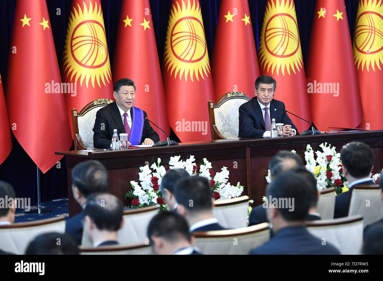 Bishkek, Kyrgyzstan. 13th June, 2019. Chinese President Xi Jinping and his Kyrgyz counterpart Sooronbay Jeenbekov meet the press after their talks in Bishkek, Kyrgyzstan, June 13, 2019. Xi and Jeenbekov held talks here Thursday, agreeing to take their countries' comprehensive strategic partnership to new heights. Credit: Yin Bogu/Xinhua/Alamy Live News - Stock Image