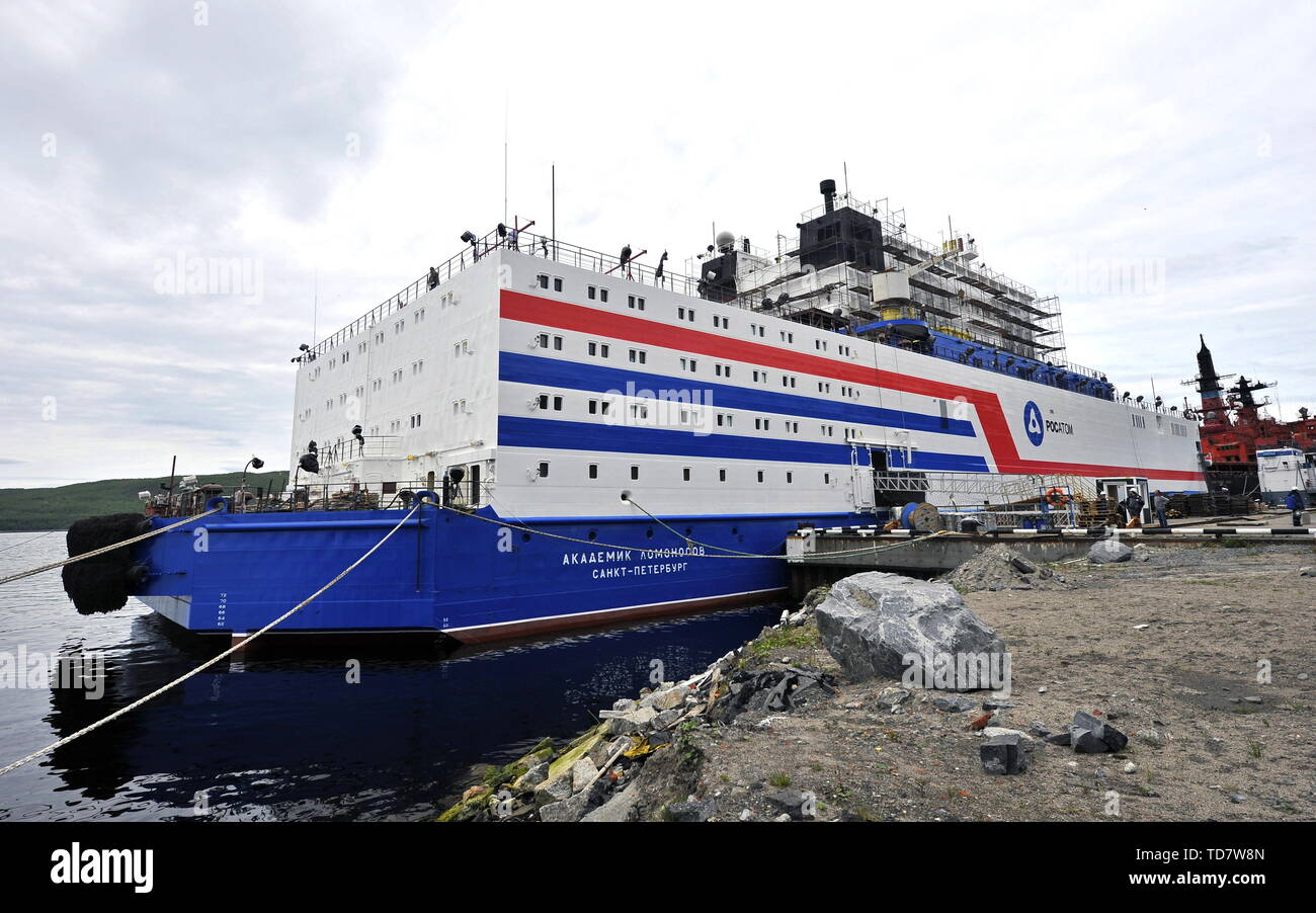 Murmansk, Russia. 13th June, 2019. MURMANSK, RUSSIA - JUNE 13, 2019: Workers paint the hull of Akademik Lomonosov, a floating nuclear power unit, at the Atomflot base; being part of a floating nuclear power station, the vessel belongs to a new class of energy sources based on Russian nuclear shipbuilding technologies. Lev Fedoseyev/TASS Credit: ITAR-TASS News Agency/Alamy Live News - Stock Image
