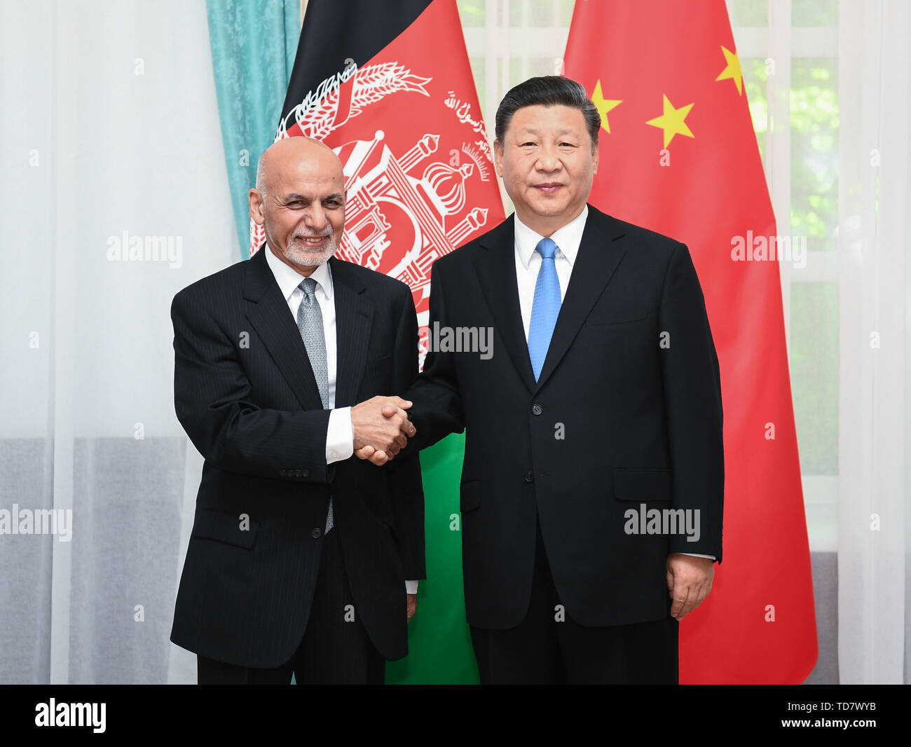 Bishkek, Kyrgyzstan. 13th June, 2019. Chinese President Xi Jinping meets with Afghan President Mohammad Ashraf Ghani in Bishkek, Kyrgyzstan, June 13, 2019. Credit: Xie Huanchi/Xinhua/Alamy Live News - Stock Image