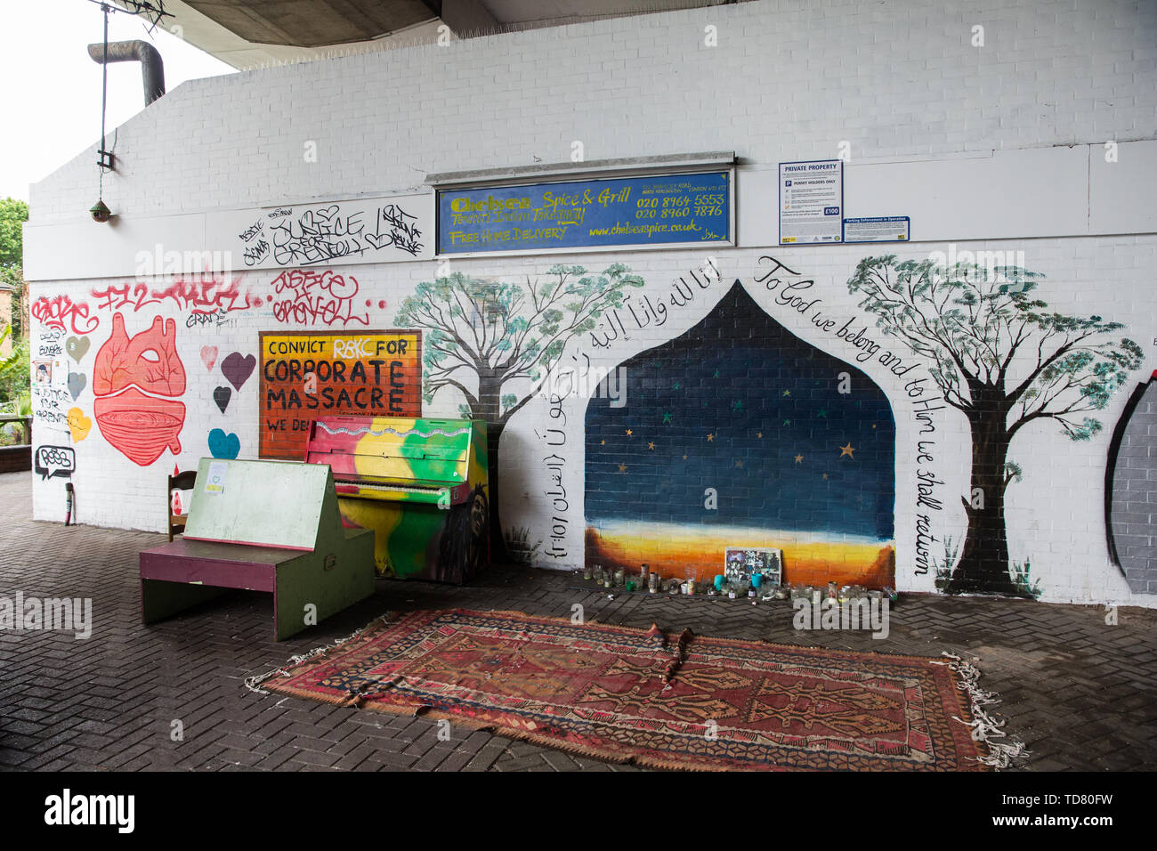 London, UK. 13 June, 2019. Murals and a prayer space underneath the Westway close to the Grenfell Tower in North Kensington. Tomorrow, the Grenfell community will mark the second anniversary of the Grenfell Tower fire on 14th June 2017 in which at least 72 people died and over 70 were injured. Two years on, some family members remain in temporary accommodation and many are still traumatised. Phase 2 of the Grenfell Inquiry will begin in 2020, with criminal investigation findings expected to be sent to the Crown Prosecution Service in 2021. Credit: Mark Kerrison/Alamy Live News - Stock Image