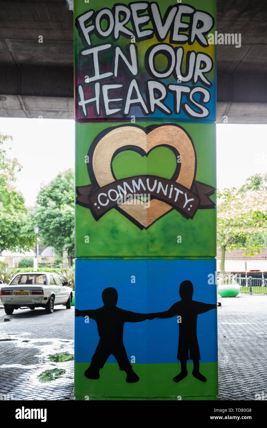 London, UK. 13 June, 2019. A mural underneath the Westway close to the Grenfell Tower in North Kensington. Tomorrow, the Grenfell community will mark the second anniversary of the Grenfell Tower fire on 14th June 2017 in which at least 72 people died and over 70 were injured. Two years on, some family members remain in temporary accommodation and many are still traumatised. Phase 2 of the Grenfell Inquiry will begin in 2020, with criminal investigation findings expected to be sent to the Crown Prosecution Service in 2021. Credit: Mark Kerrison/Alamy Live News - Stock Image