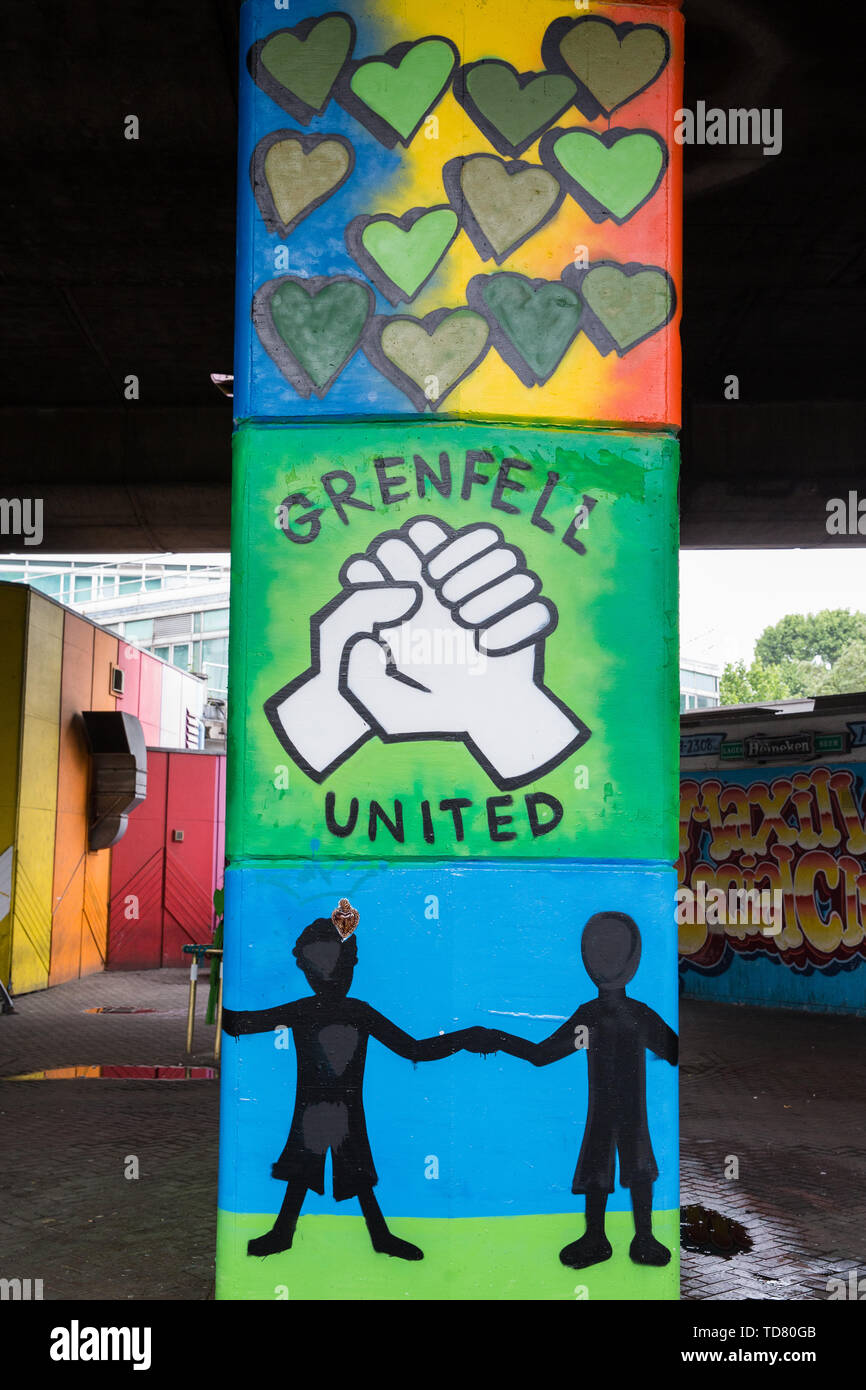 London, UK. 13 June, 2019. Murals underneath the Westway close to the Grenfell Tower in North Kensington. Tomorrow, the Grenfell community will mark the second anniversary of the Grenfell Tower fire on 14th June 2017 in which at least 72 people died and over 70 were injured. Two years on, some family members remain in temporary accommodation and many are still traumatised. Phase 2 of the Grenfell Inquiry will begin in 2020, with criminal investigation findings expected to be sent to the Crown Prosecution Service in 2021. Credit: Mark Kerrison/Alamy Live News - Stock Image