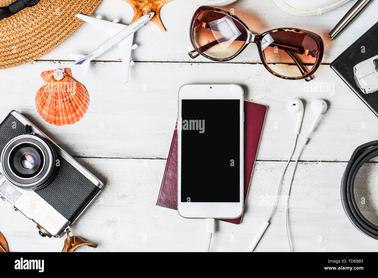 Summer holiday background, Beach accessories on white wood and copy space ,Vacation and travel items concept. - Stock Image