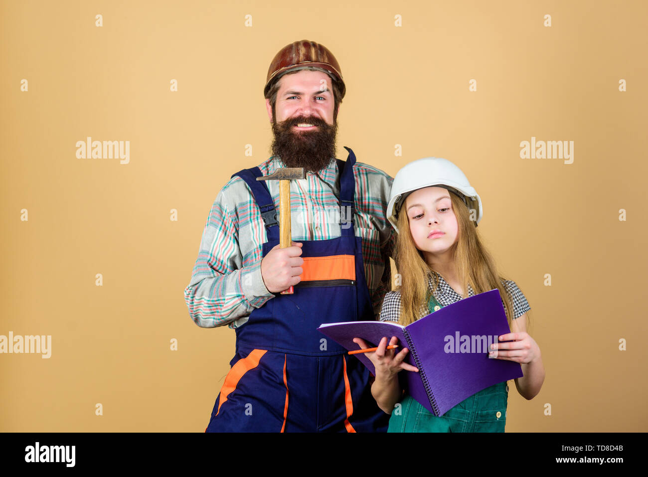 Father bearded man and daughter hard hat helmet uniform renovating home. Home improvement activity. Kid girl planning renovation. Child renovation roo - Stock Image