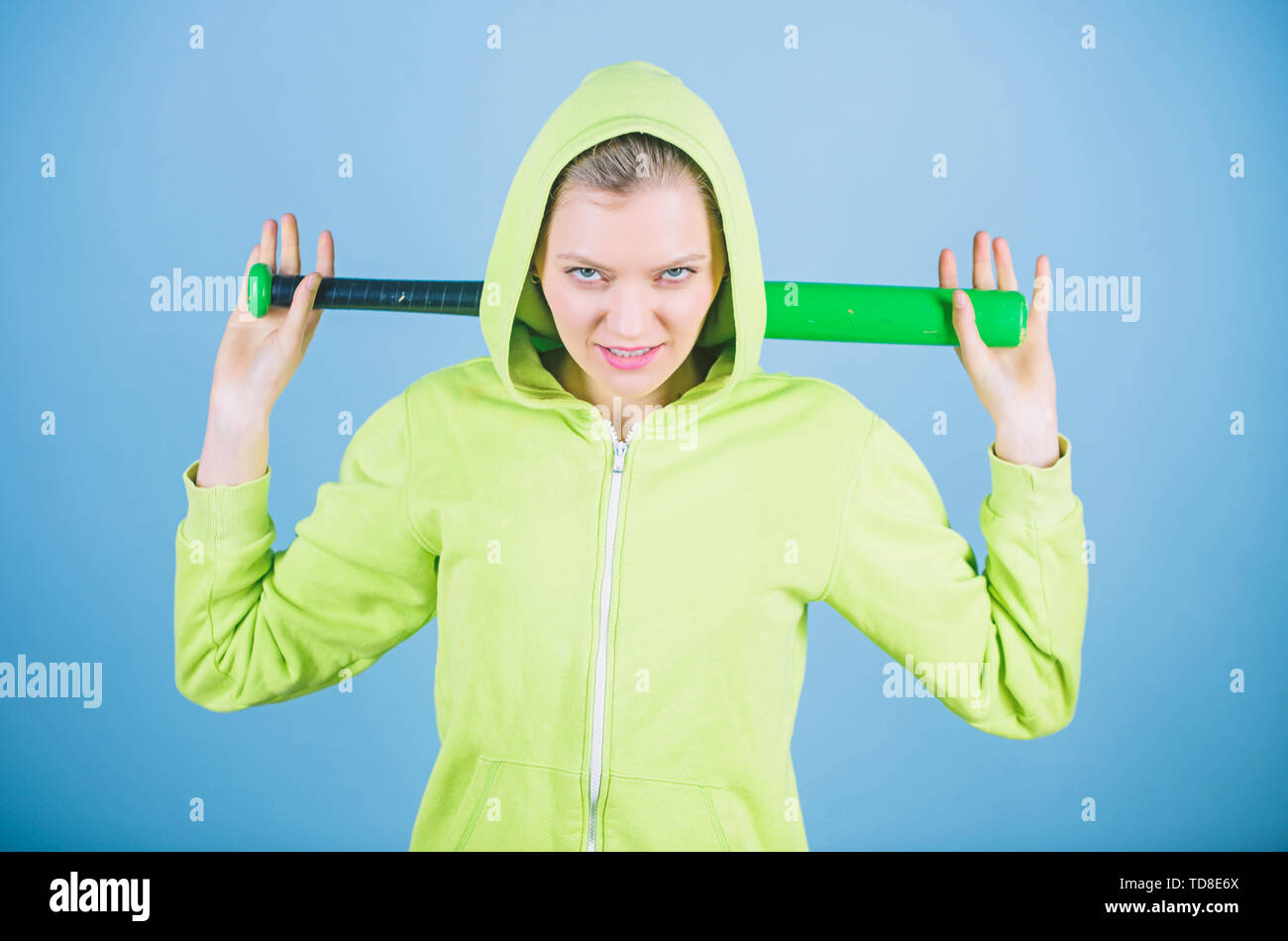 Bandit gang and conflict. aggressive woman with bat from bandit gang. woman workout with baseball bat. Fighting with aggression. Sport equipment. Athl - Stock Image