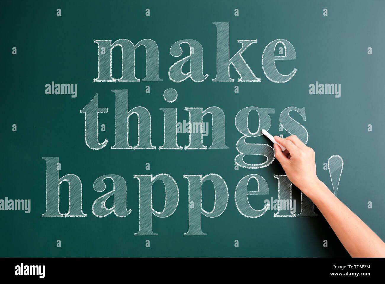 make things happen written on blackboard - Stock Image
