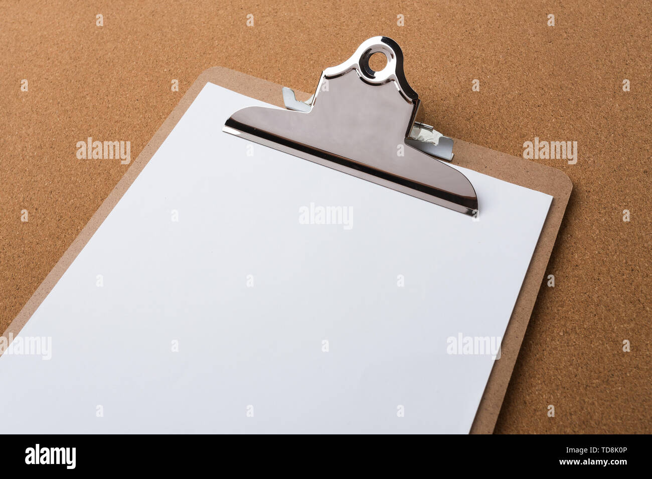 Wooden clipboard on wood background - Stock Image