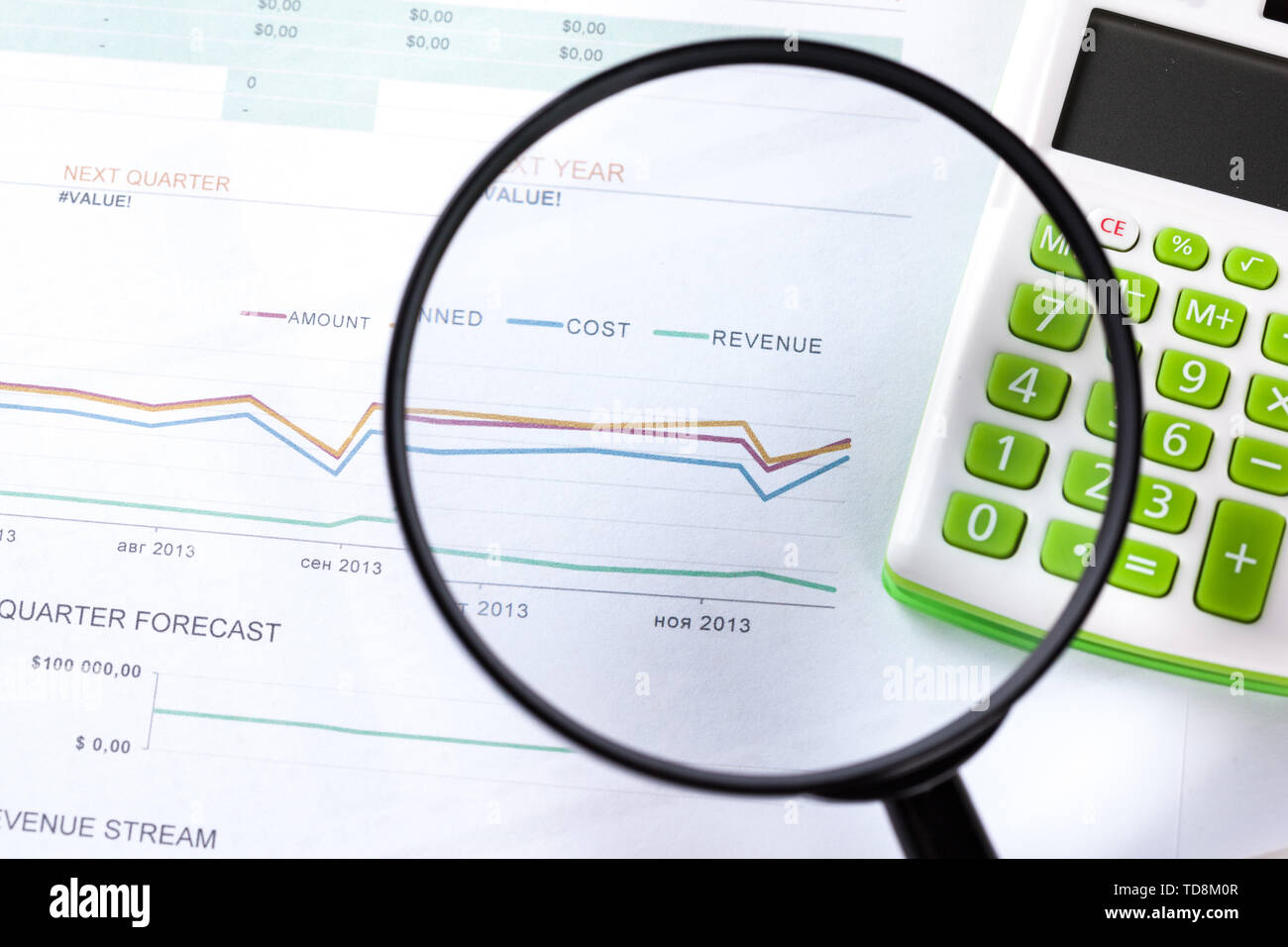 work with a magnifying glass, a calculator and papers - Stock Image