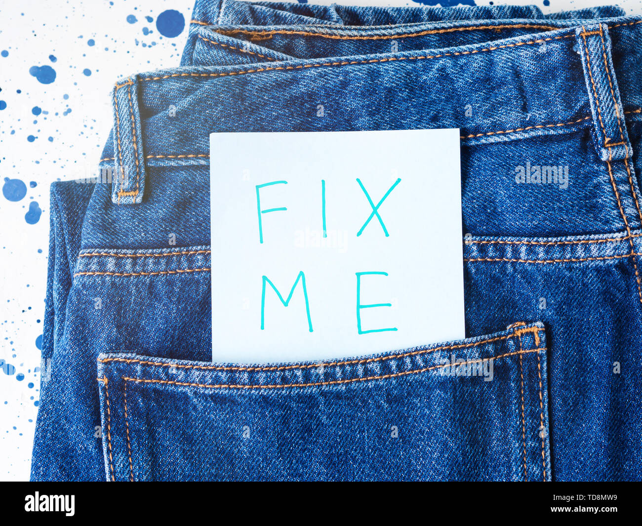 Fix me. Written message in jeans pocket. Request of help concept. - Stock Image