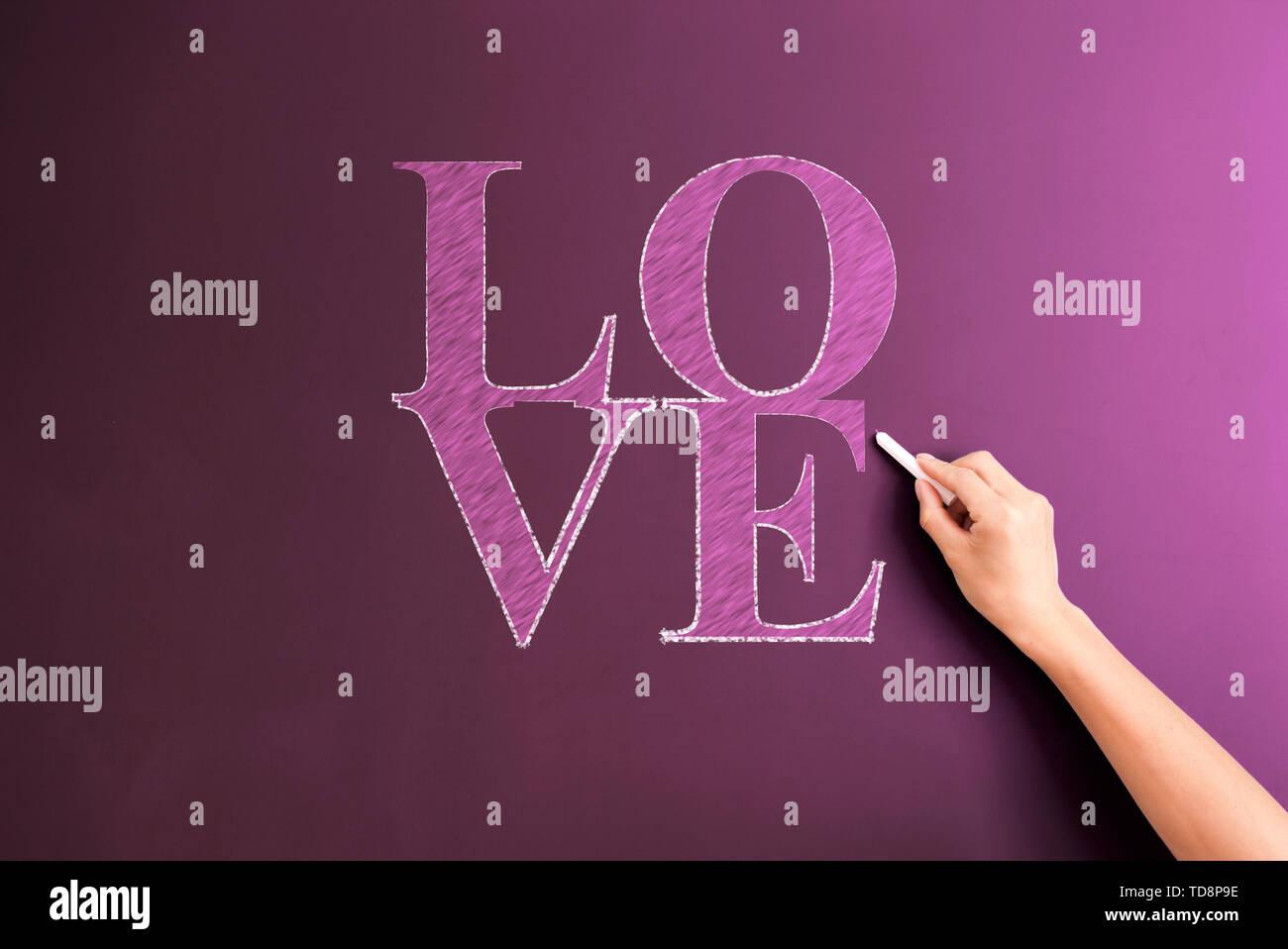 written on blackboard - Stock Image