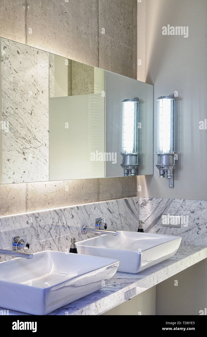 Modern Eclectic Bathroom With Industrial Wall Light And Mirror With Back Light Uk Irish Use Only Stock Photo Alamy