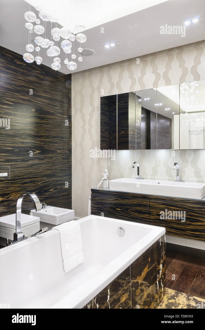 Portoro Marble Tiled Bathtub And Washbasin On Ebony Veneer Cabinet In Modern Bathroom Uk Irish Use Only Stock Photo Alamy