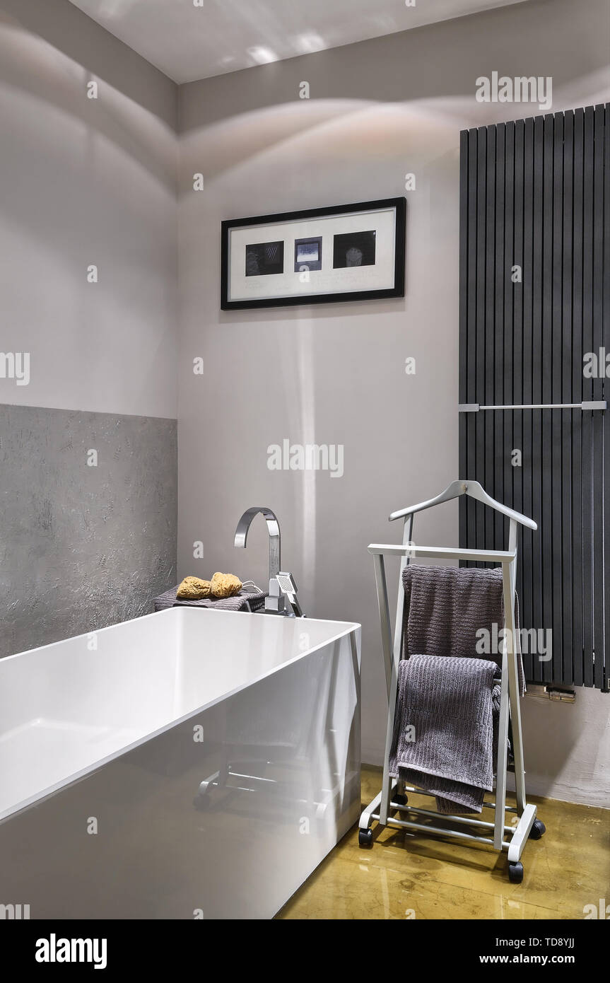 Clothes Horse Storage Racks Next To Freestanding Bathtub In Modern Bathroom Uk Irish Use Only Stock Photo Alamy