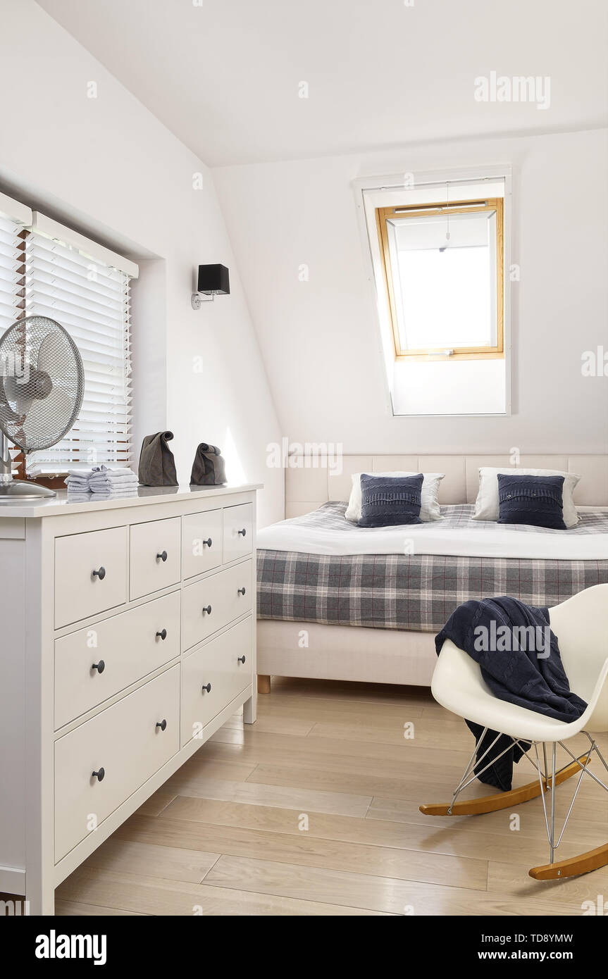Chest Of Drawers And Eames Rocker In Modern Bedroom With Double Bed Uk And Irish Rights Only Stock Photo Alamy