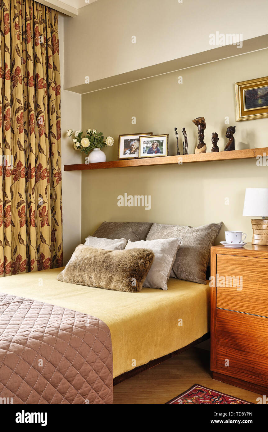 Shelving Above Bed In Modern Bedroom Uk Irish Use Only Stock Photo Alamy
