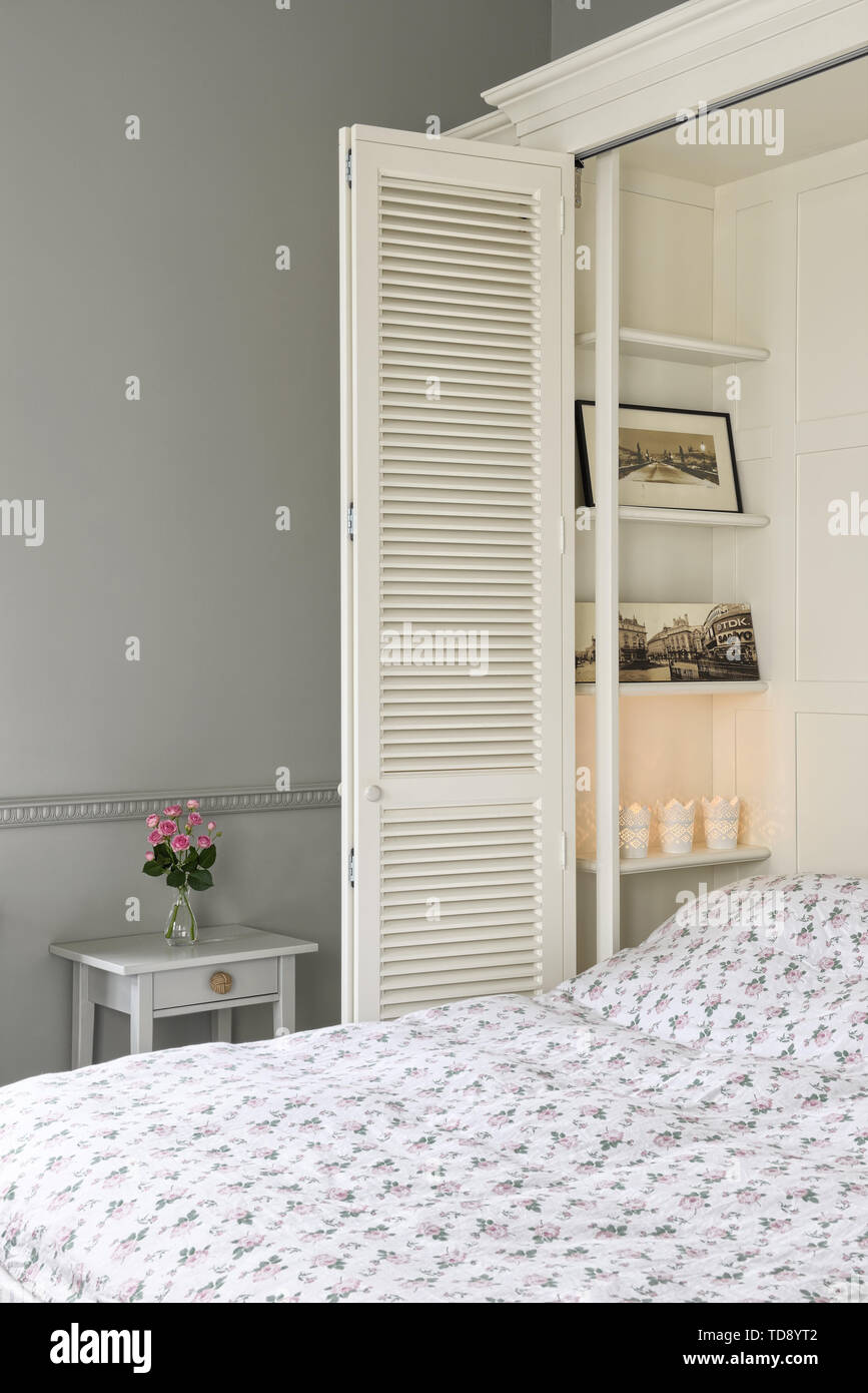 Hidden fold-out wardrobe bed in spacious open plan studio apartment   UK & IRISH USE ONLY - Stock Image
