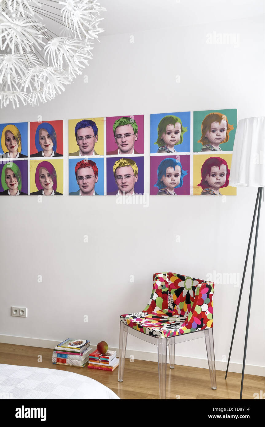 Andy Warhol inspired pop art family portraits on bedroom wall   UK & IRISH USE ONLY - Stock Image