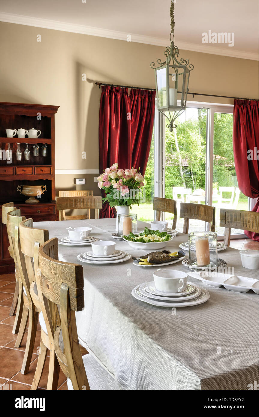 Table laid for lunch in traditional dining room    UK AND IRISH RIGHTS ONLY - Stock Image