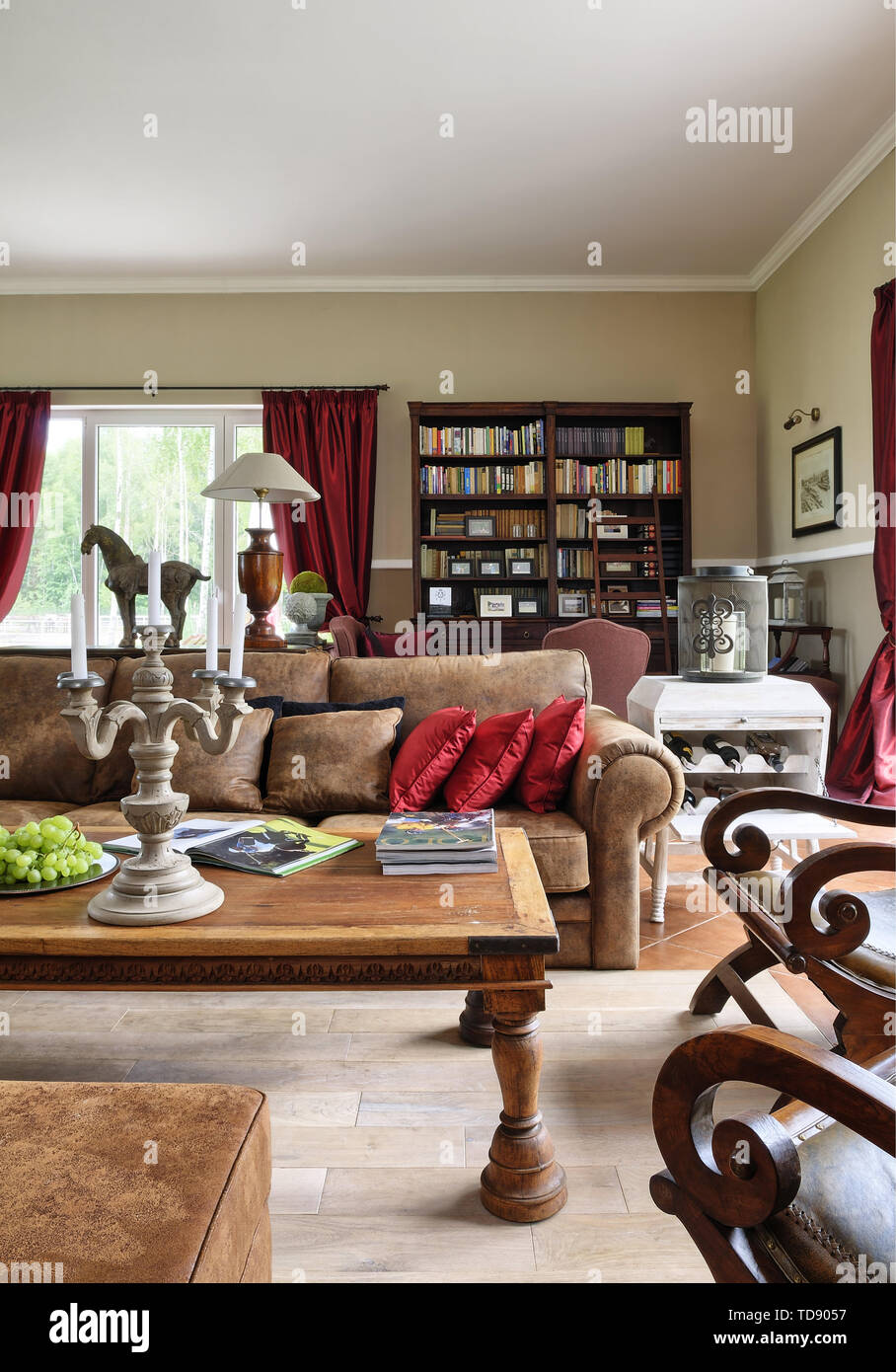 Coffee table in front of leather club sofa in traditional style sitting room    UK AND IRISH RIGHTS ONLY - Stock Image