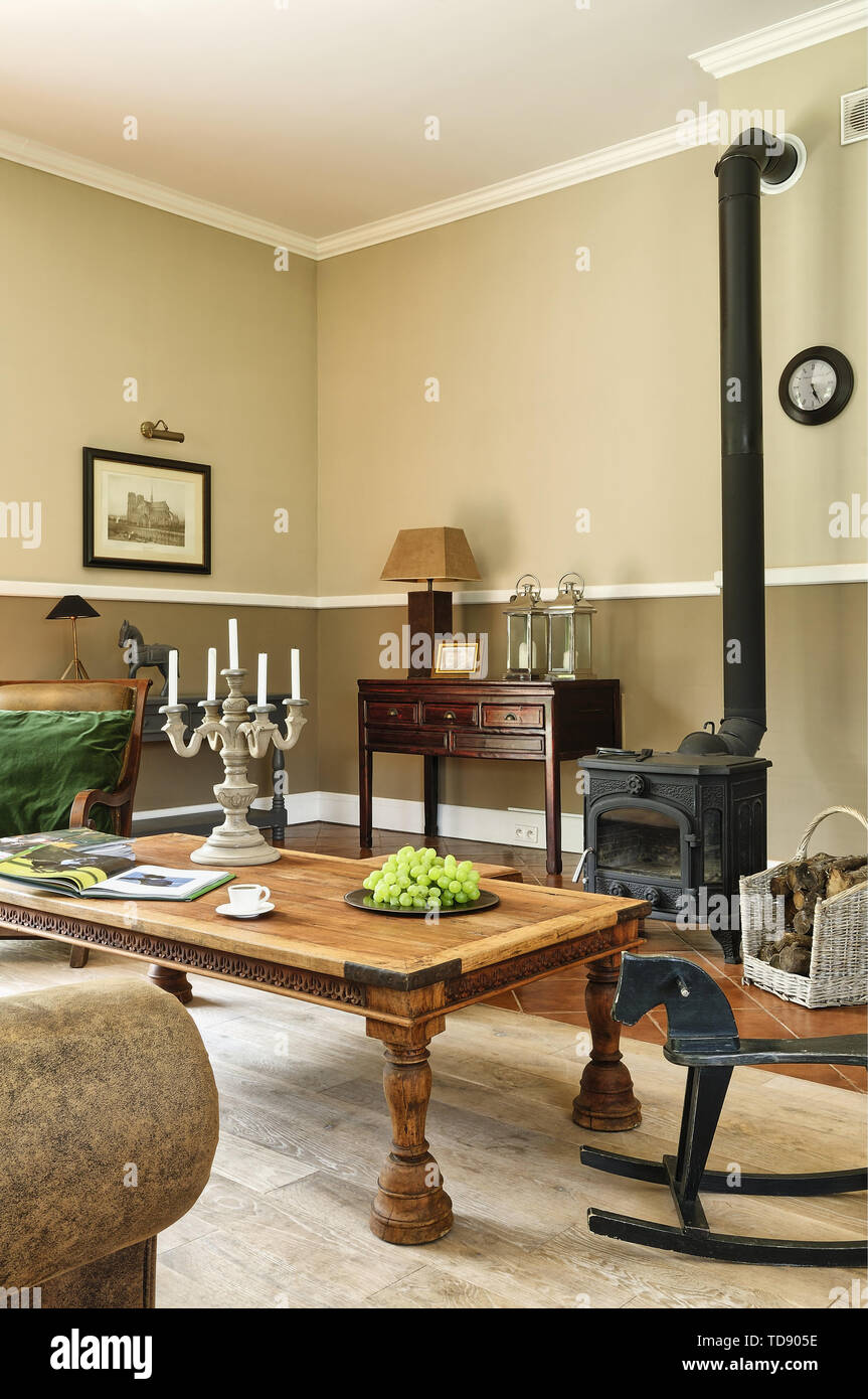Traditional style sitting room with wood burning stove    UK AND IRISH RIGHTS ONLY - Stock Image