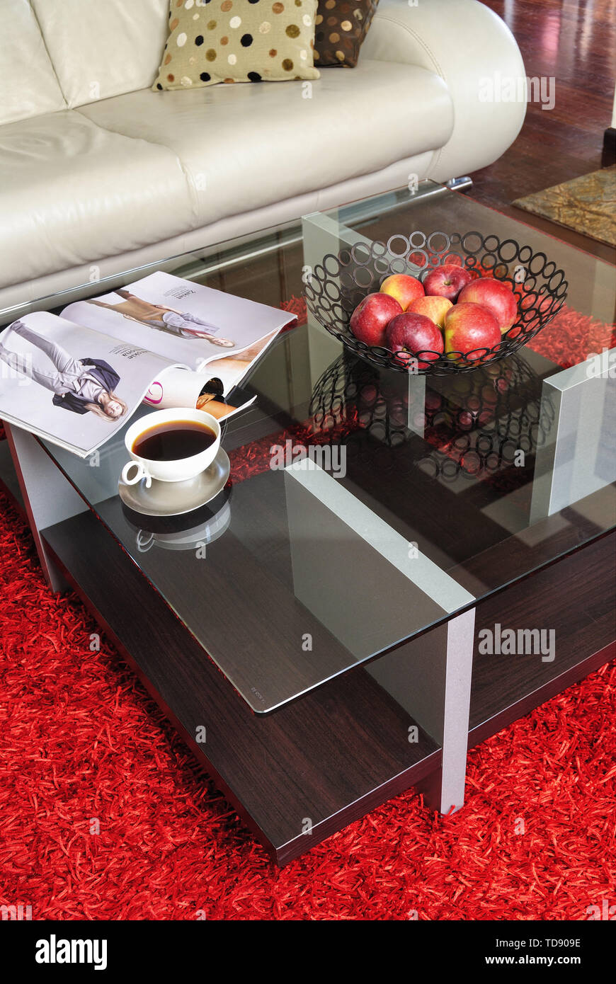 Cup Of Coffee And Apples In Wire Fruit Bowl On Glass Topped Coffee