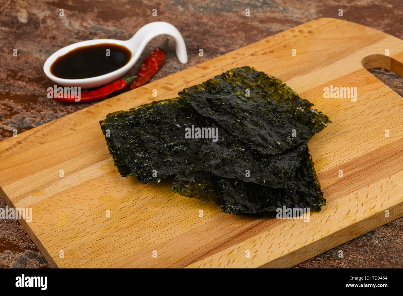 Tasty Nori chips with soya sauce - Stock Image