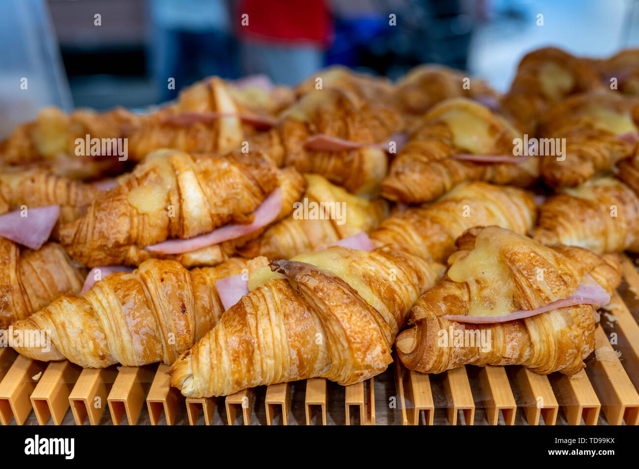 Closeup photo of cheese ham croissant in pastry shop - Stock Image