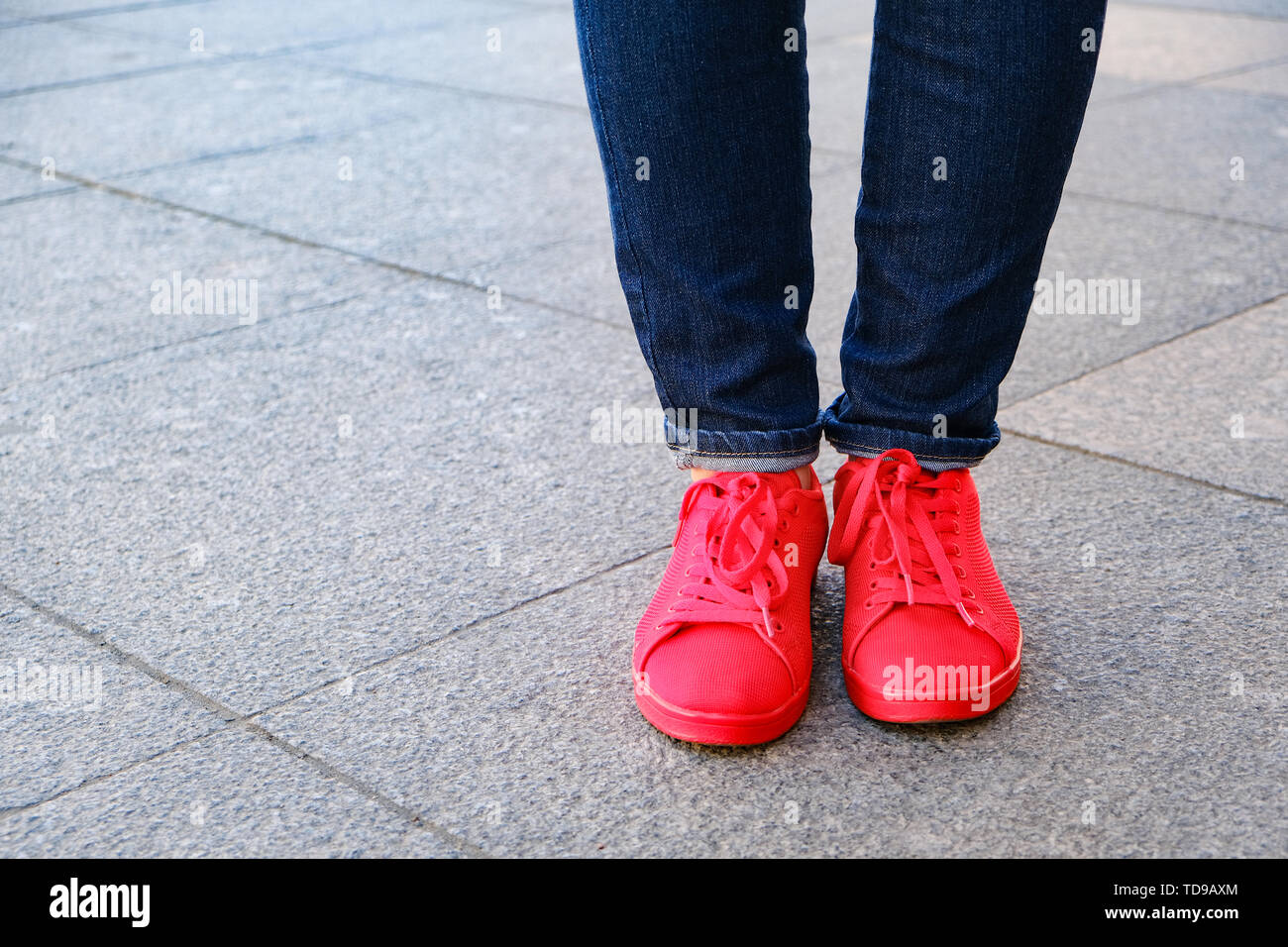 shoes. Red sneakers and jeans. Waiting