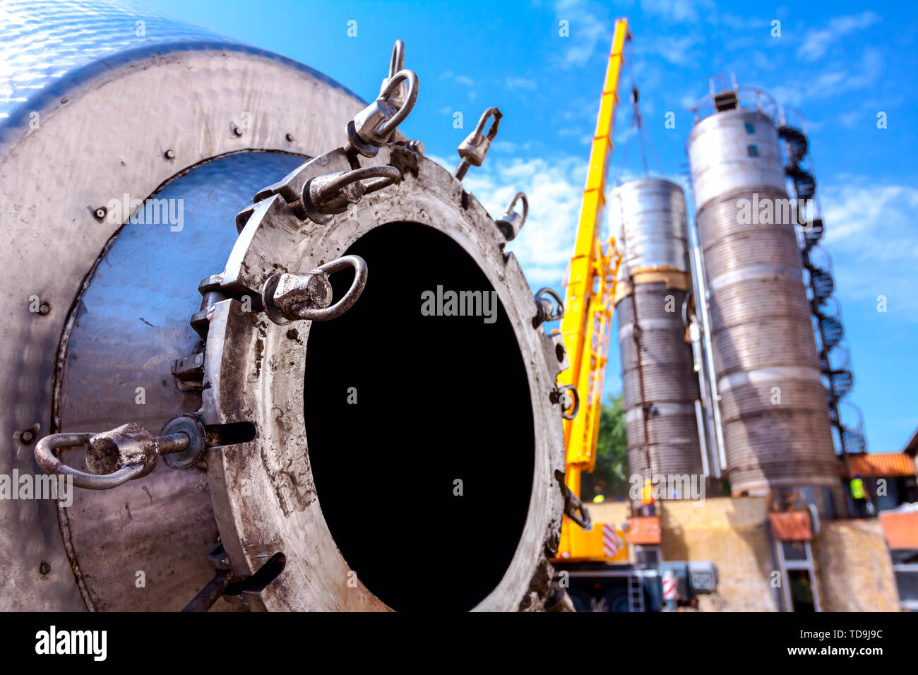 Bottom of disassembled obsolete massive old metal silos waiting for cassation. - Stock Image