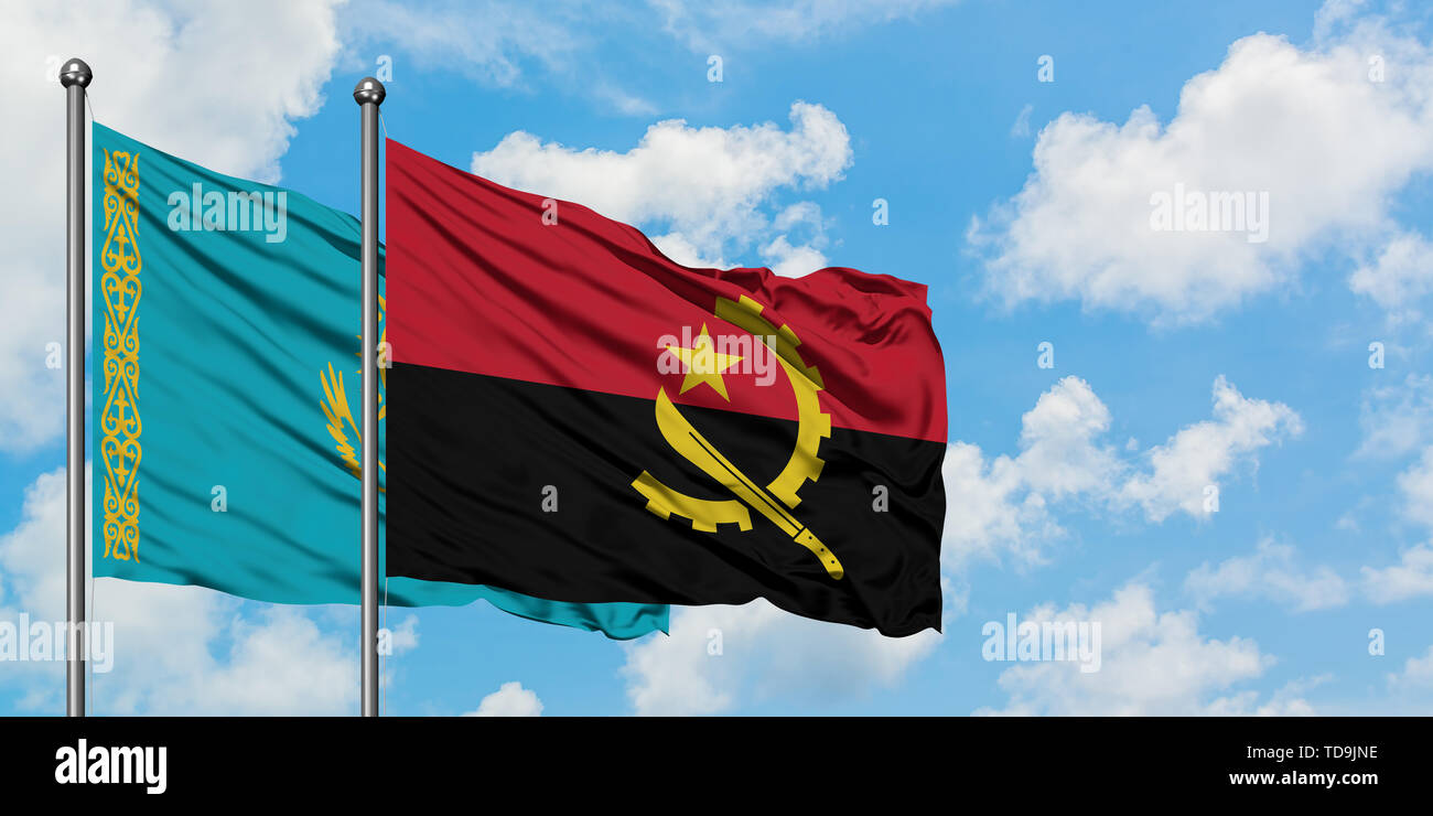 Kazakhstan and Angola flag waving in the wind against white cloudy blue sky together. Diplomacy concept, international relations. - Stock Image