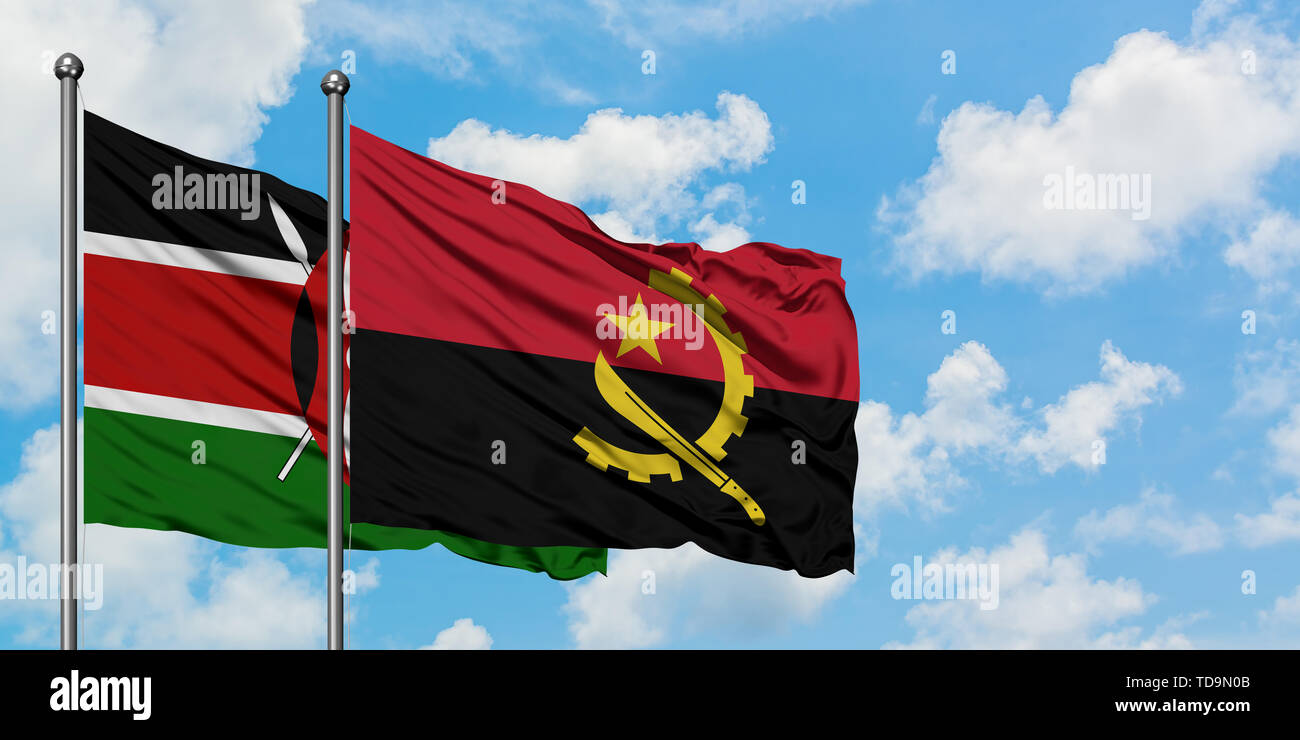 Kenya and Angola flag waving in the wind against white cloudy blue sky together. Diplomacy concept, international relations. - Stock Image