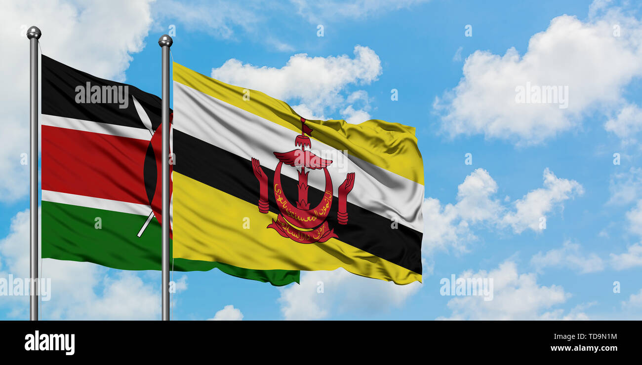 Kenya and Brunei flag waving in the wind against white cloudy blue sky together. Diplomacy concept, international relations. - Stock Image
