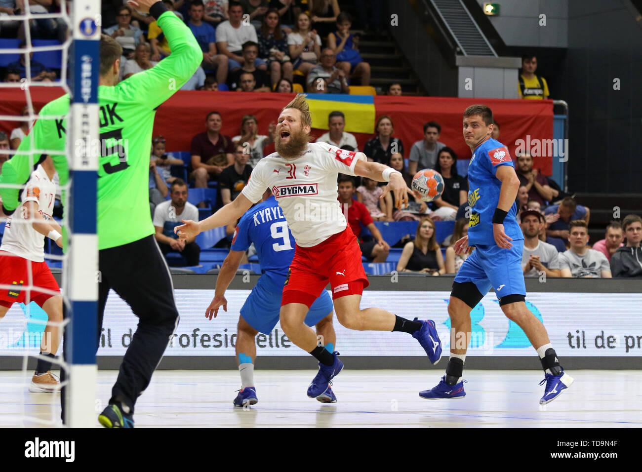 KYIV, UKRAINE - JUNE 12, 2019: Nikolaj Oris NIELSEN of Denmark (in White) attacks during the EHF EURO 2020 Qualifiers handball game Ukraine v Denmark  Stock Photo