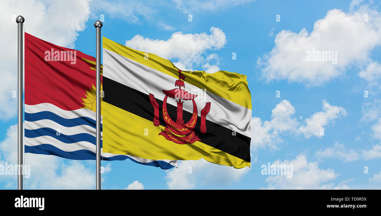 Kiribati and Brunei flag waving in the wind against white cloudy blue sky together. Diplomacy concept, international relations. - Stock Image